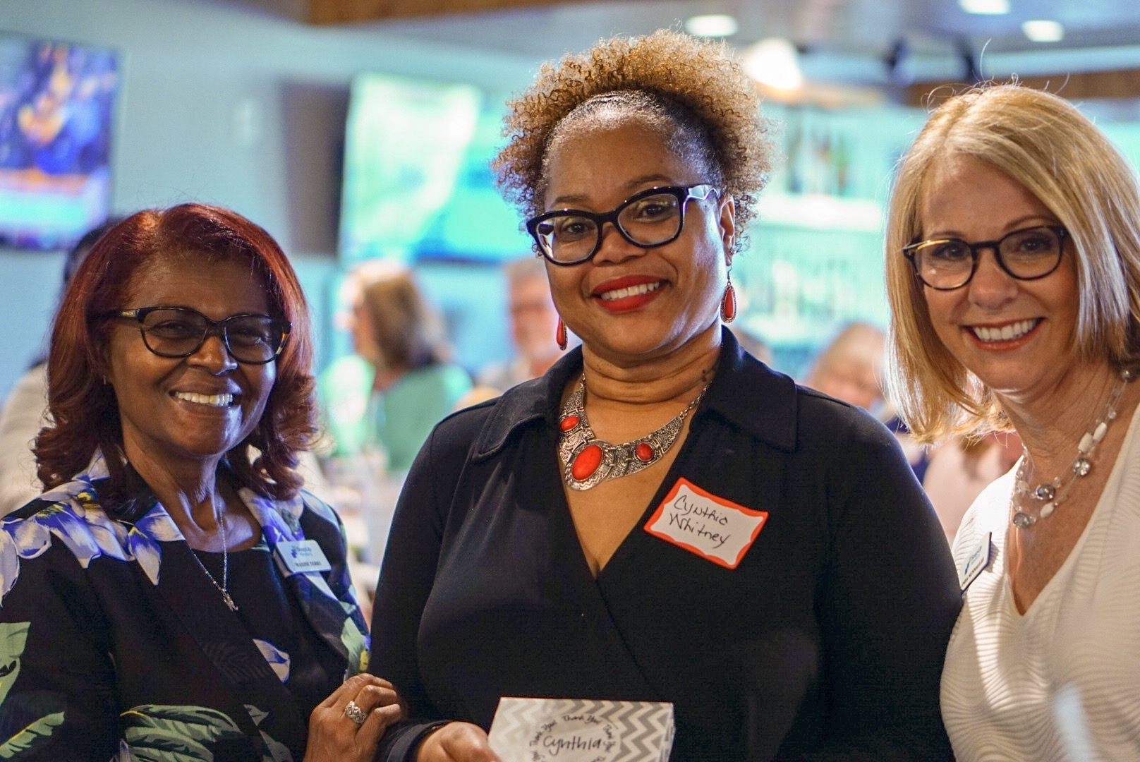 Cynthia Whitney-Hopkins receives her award from Maxine Terry and Linda Nunnallee at the Volunteer Appreciation Party at Cantina 18 on April 29, 2019.