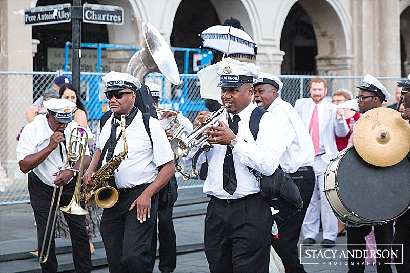 A second line is a parade where the bride and groom lead their guests from their ceremony to their reception, all the while swinging hankies around and listening to a jazz band escort them the whole way.