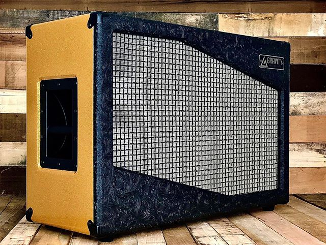 ***Gold Rush*** This is a bold and gorgeous build for @anthonybestmusic  Photos don't do this thing justice.  Tolex: Front/Back - Black Western  Body - Gold Sparkle Grill Cloth: Marshall Large Check Speakers: @celestionuk  A-Type/V-Type  #allthatglittersisgold #gold #goldrush #gravityenclosures #speakercab #speakercabinet #smallbusiness #pennsylvania #getloud #sound #madeinusa #geartalk #knowyourtone #guitar #guitargear #woodworking #celestion