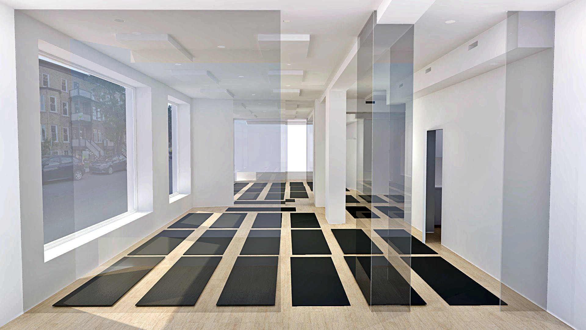The main hot flow yoga studio with mirrors on back wall
