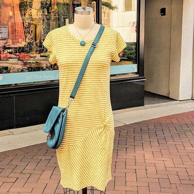 Casual Sunday vibes... Twisted yellow dress by Mod-O-Doc Bag by Haiku (made from recycled bottles!) Necklace by @amyzanekzoo, obviously #fashion #summer #downtownkalamazoo