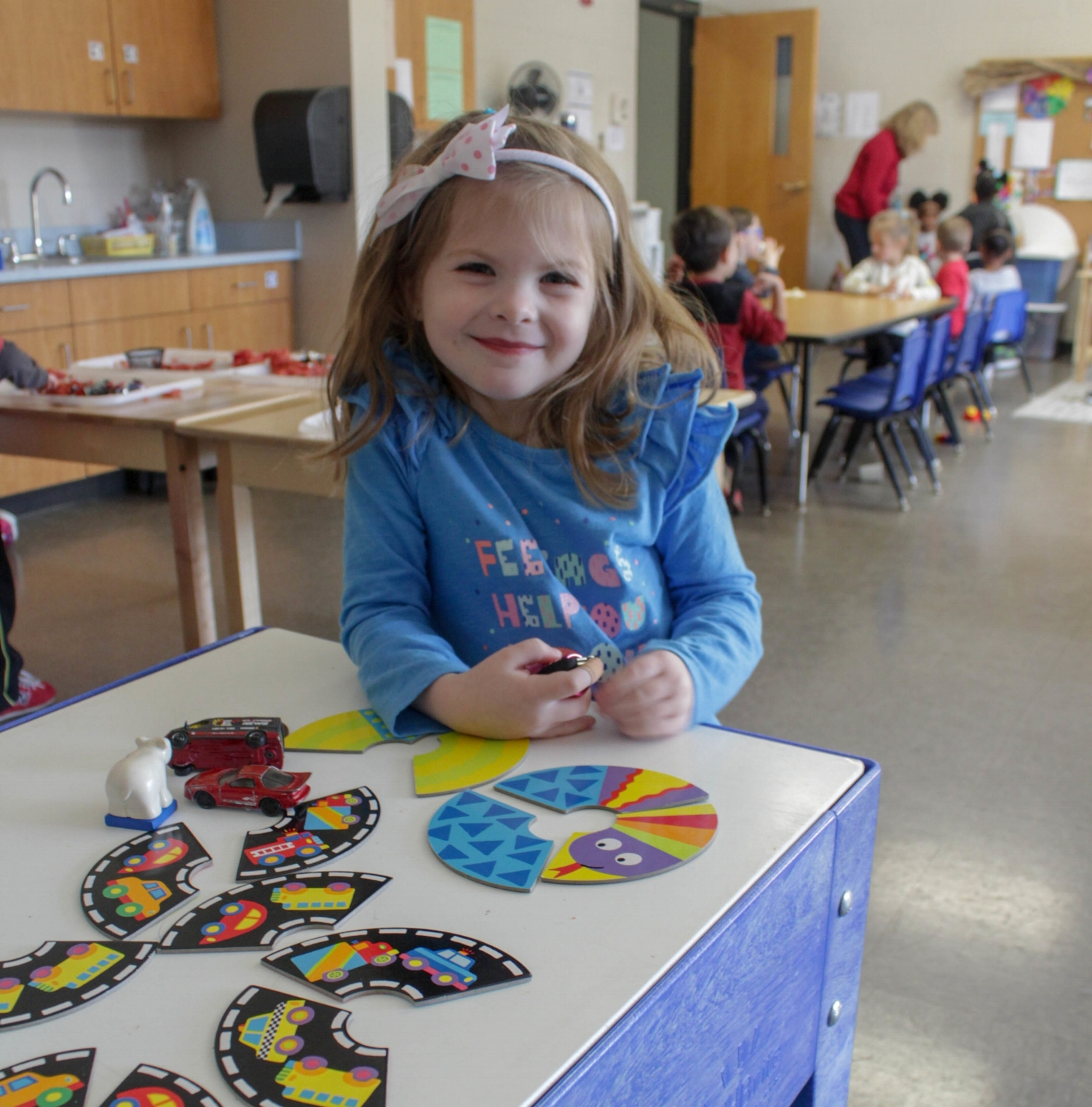 Preschool Girl Playing Puzzles