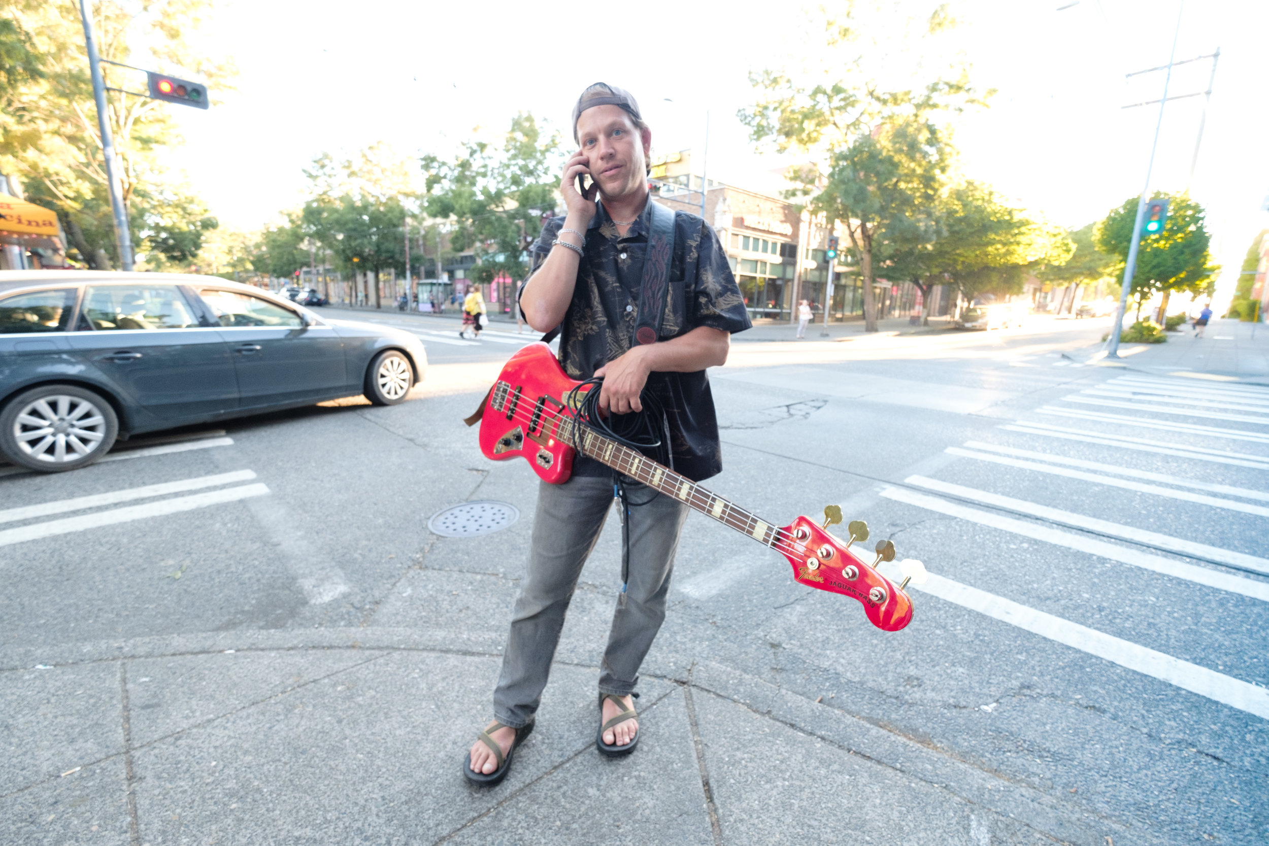 Tobias the Owl's Andrew Gemkow chilling in the green roo...intersection...before his set. Seattle Acoustic Festival, 26 August 2017.