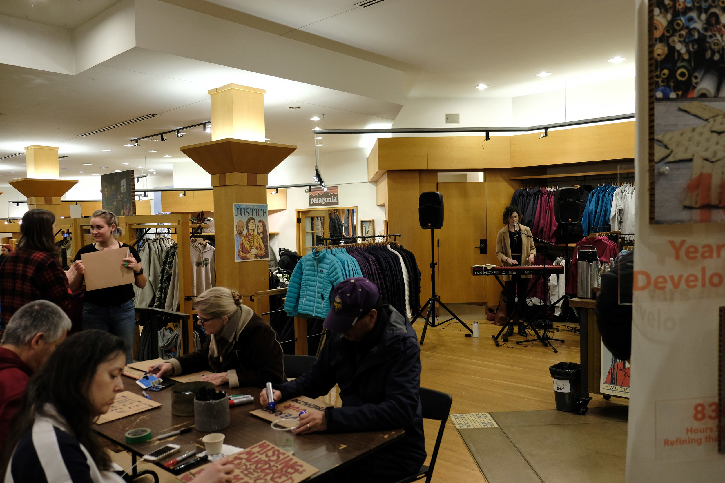 Seattle musician Katie Kuffel performs at Patagonia's sign-making event for the Women's March 2018.