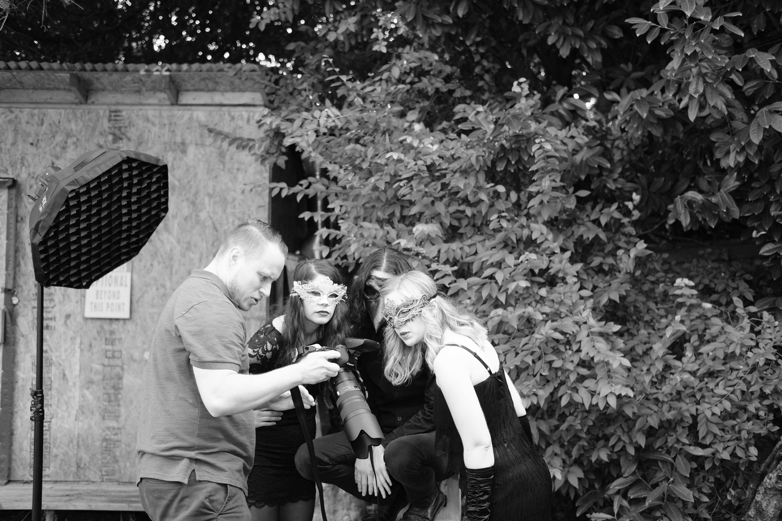Behind the Scenes at the photoshoot for the Winter Solstice Masquerade Party. Tony is conferring with Sarah St. Albin, Heather Edgley, and  Ryan Hendrickson .