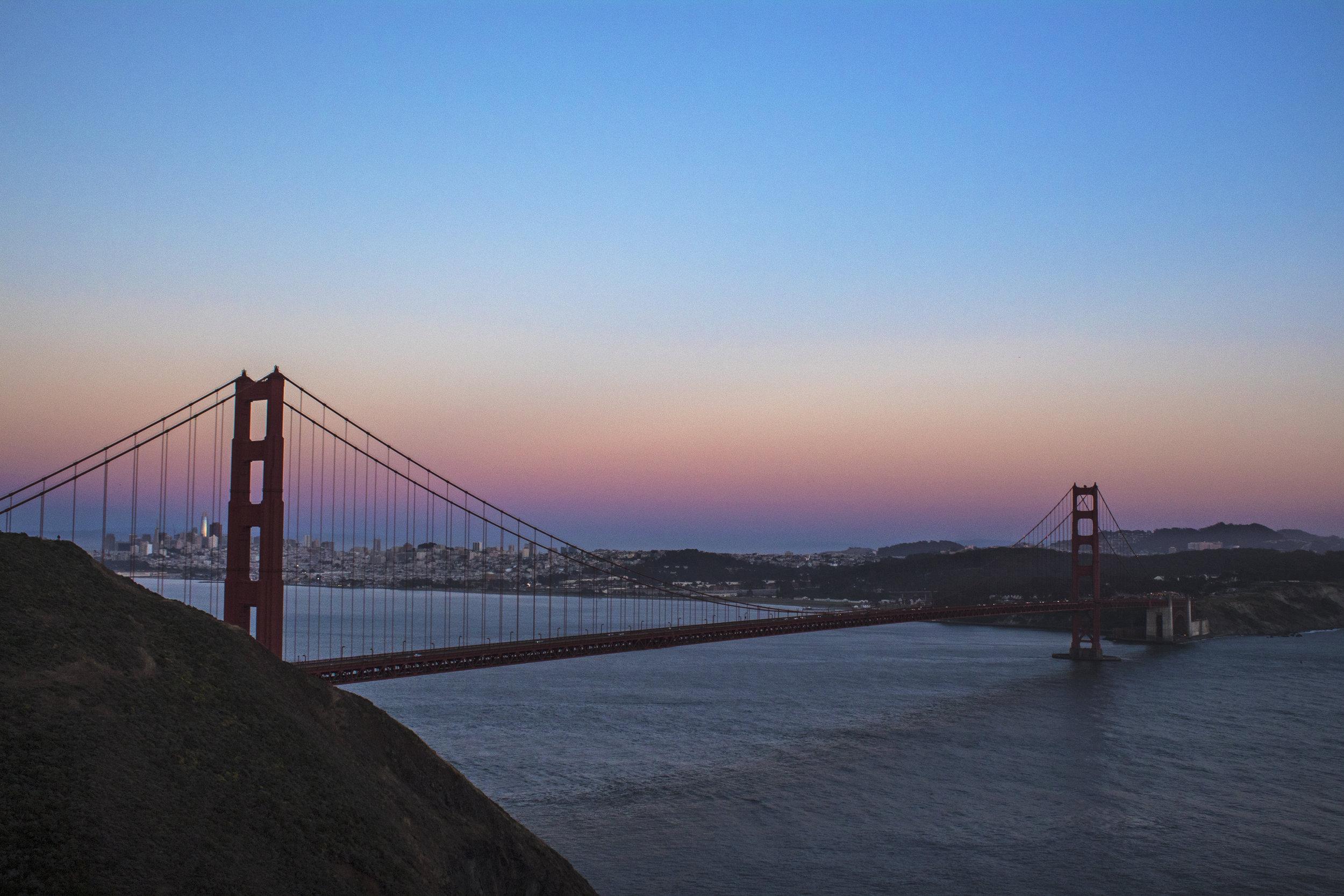 I like how this one shows the city peeking through the bridge.