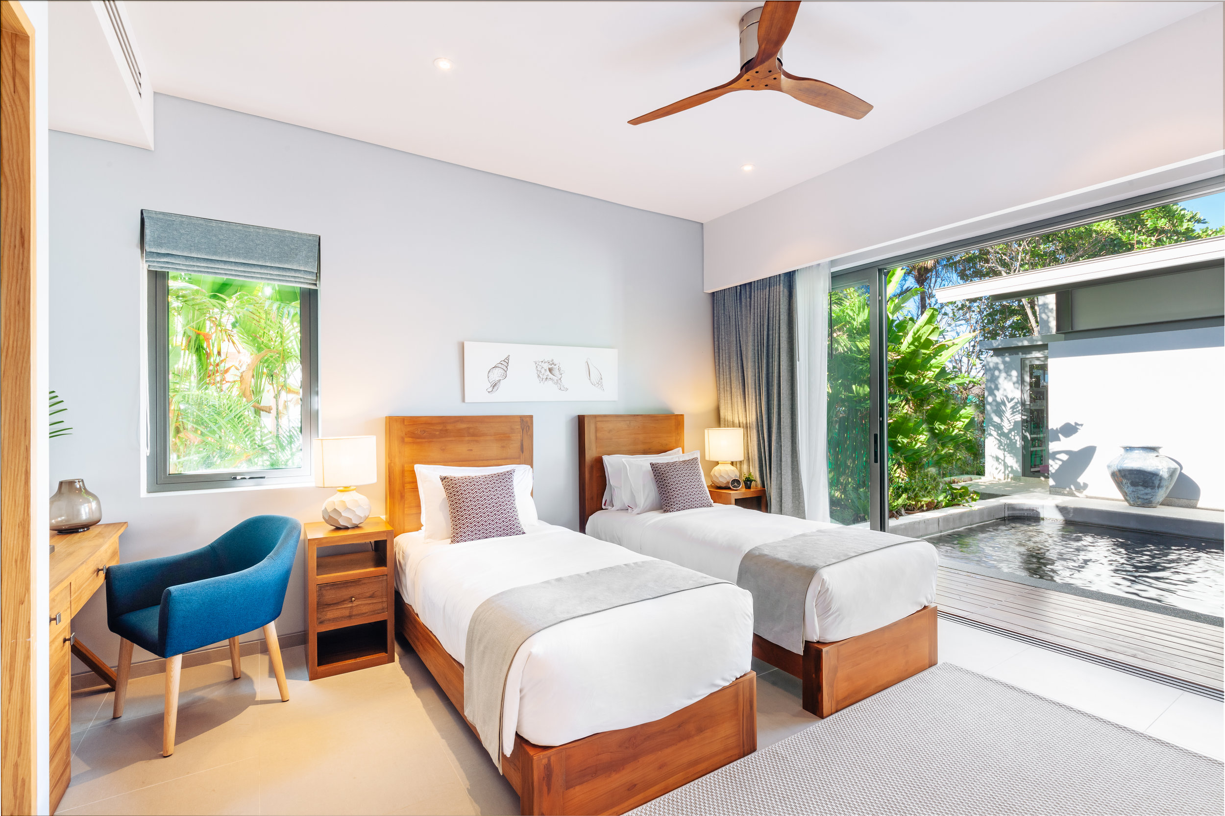Garden View - 2 Rooms - Ground floor Garden View rooms gives you instant access to tranquility. Adjacent to the Koi pond, these rooms provide an up-close view of the lush tropical garden and are just a few steps away from the pool and beach.Configuration: One King bed or two Single beds