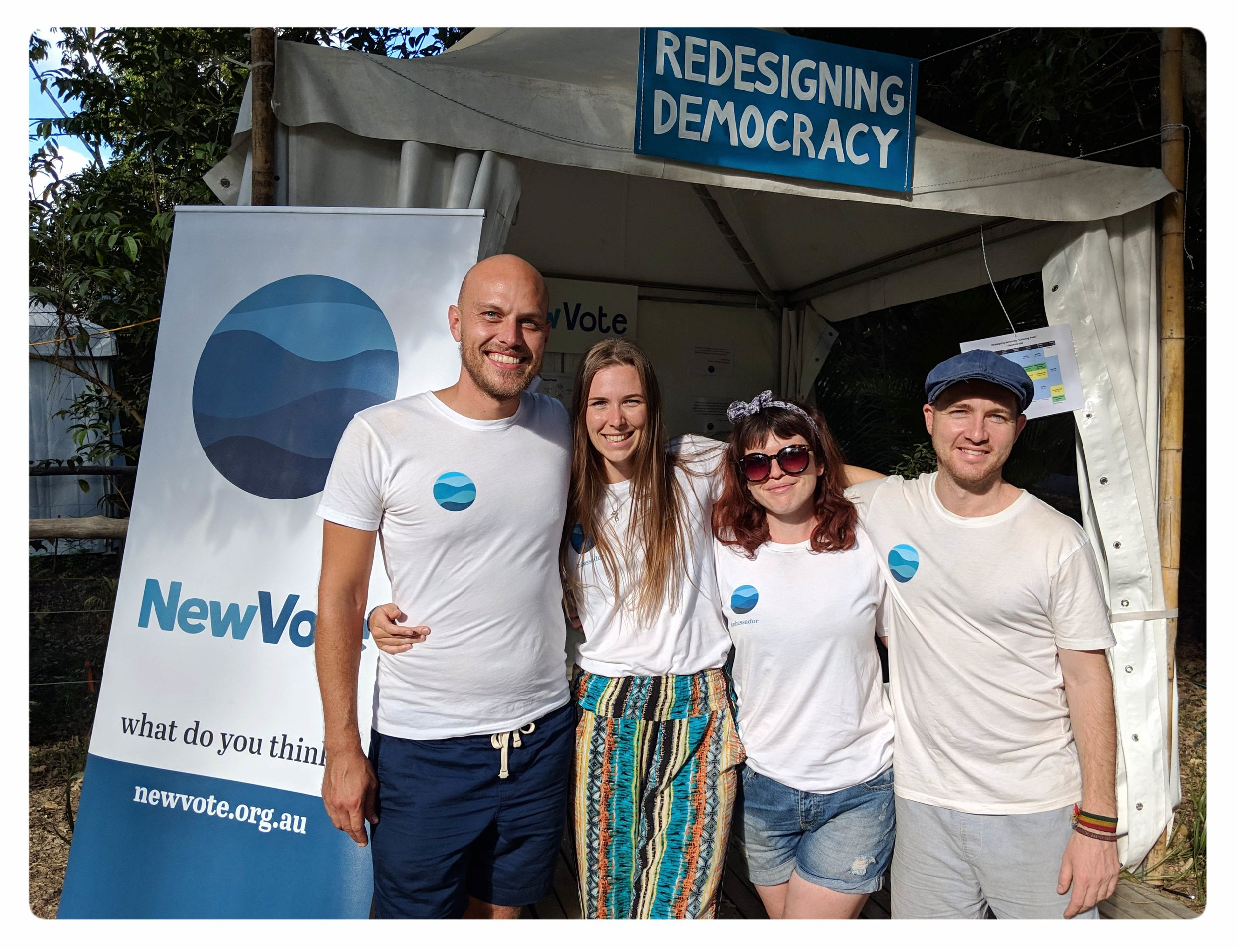 NewVote team members at the Woodford Folk Festival stall in Dec/Jan 2018/19.  Left to Right: Dion McCurdy, Holly Pearce, Lailah Sinclair and Tom Wensley