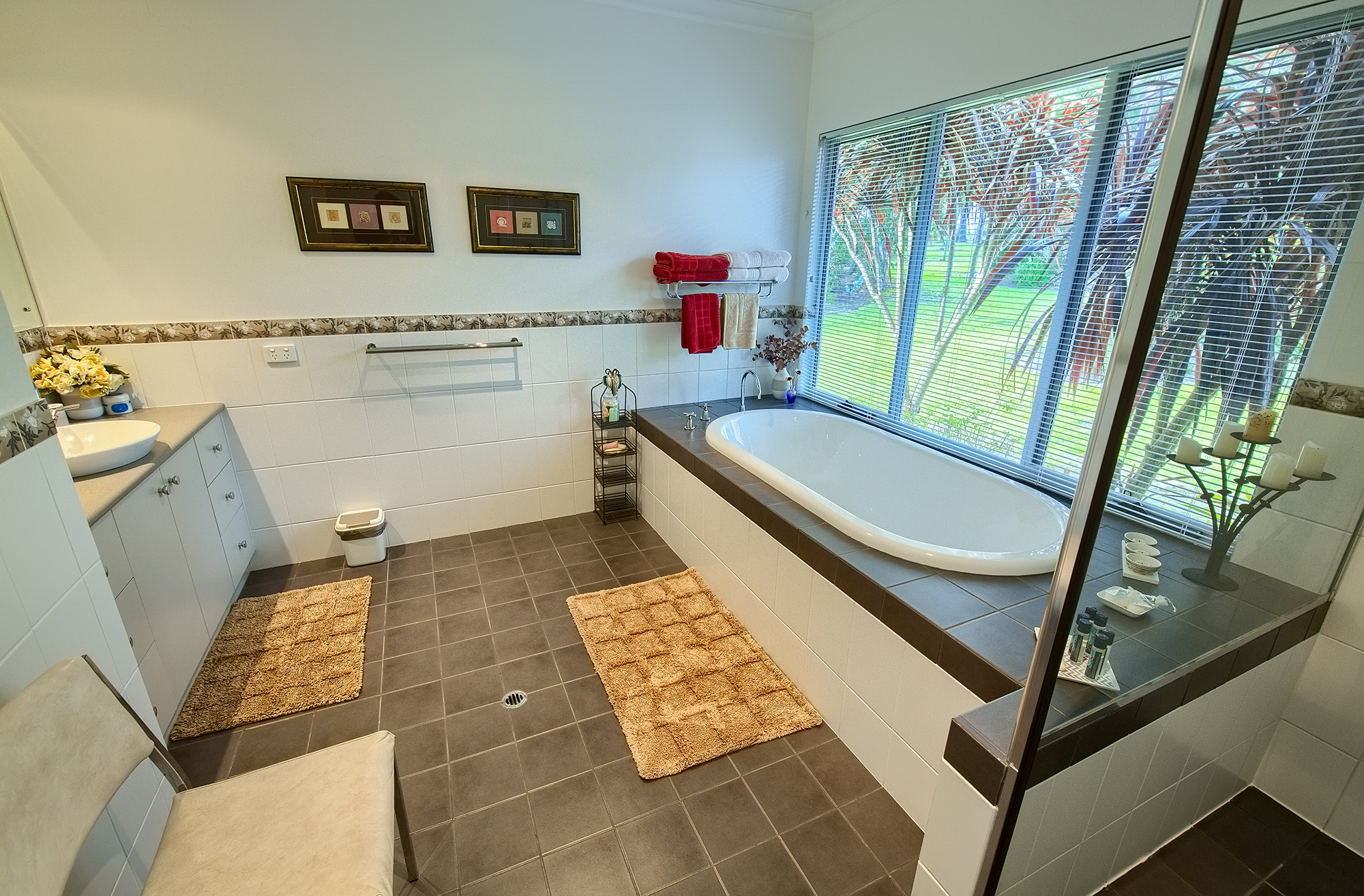 Modern Facilities - The bathroom has a large bath, shower and underfloor heating