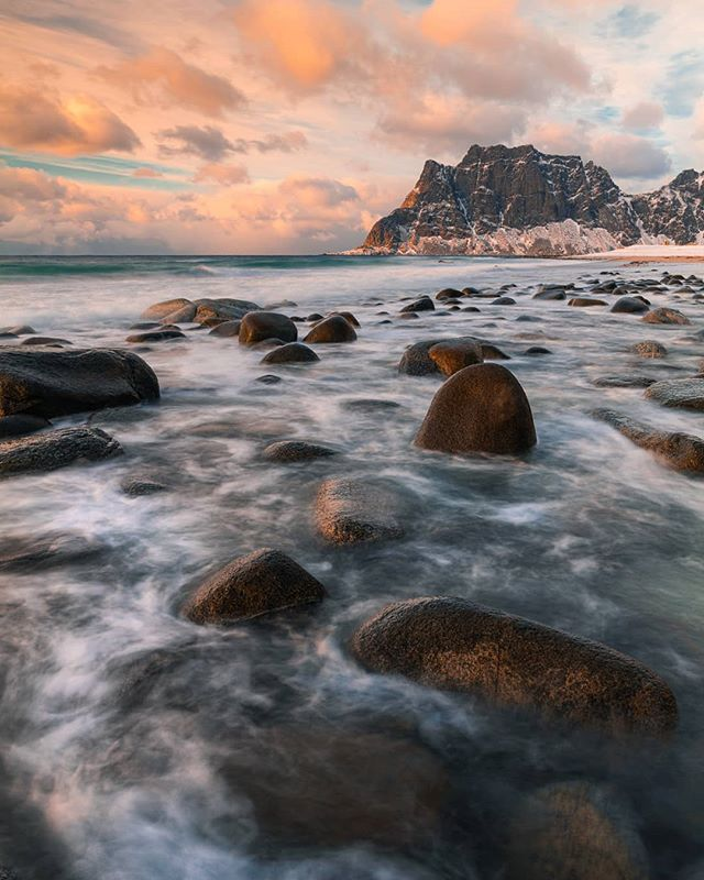 On the the icy shores of Uttakleiv Beach, Lofoten. This beautiful beach streched along this rugged coastline and with the early evening sun providing colour in the sky. It was a balancing act trying to place the tripod legs and myself on the rocks. ------------------------------------------------------------------ @lumixuk S1R +24-105mm @kasefilters_uk CPL+ 6 stop ND @benrouk Mach 3 Carbon