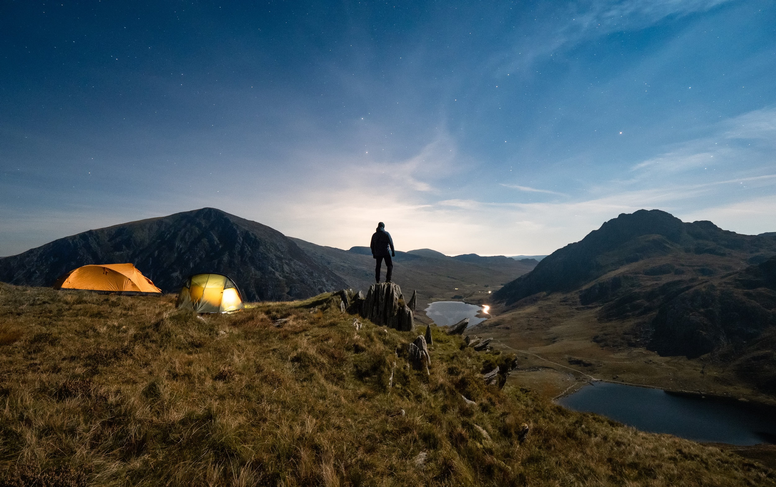 Snowdonia wild camp on the side of Y Garn under a moonlit sky.