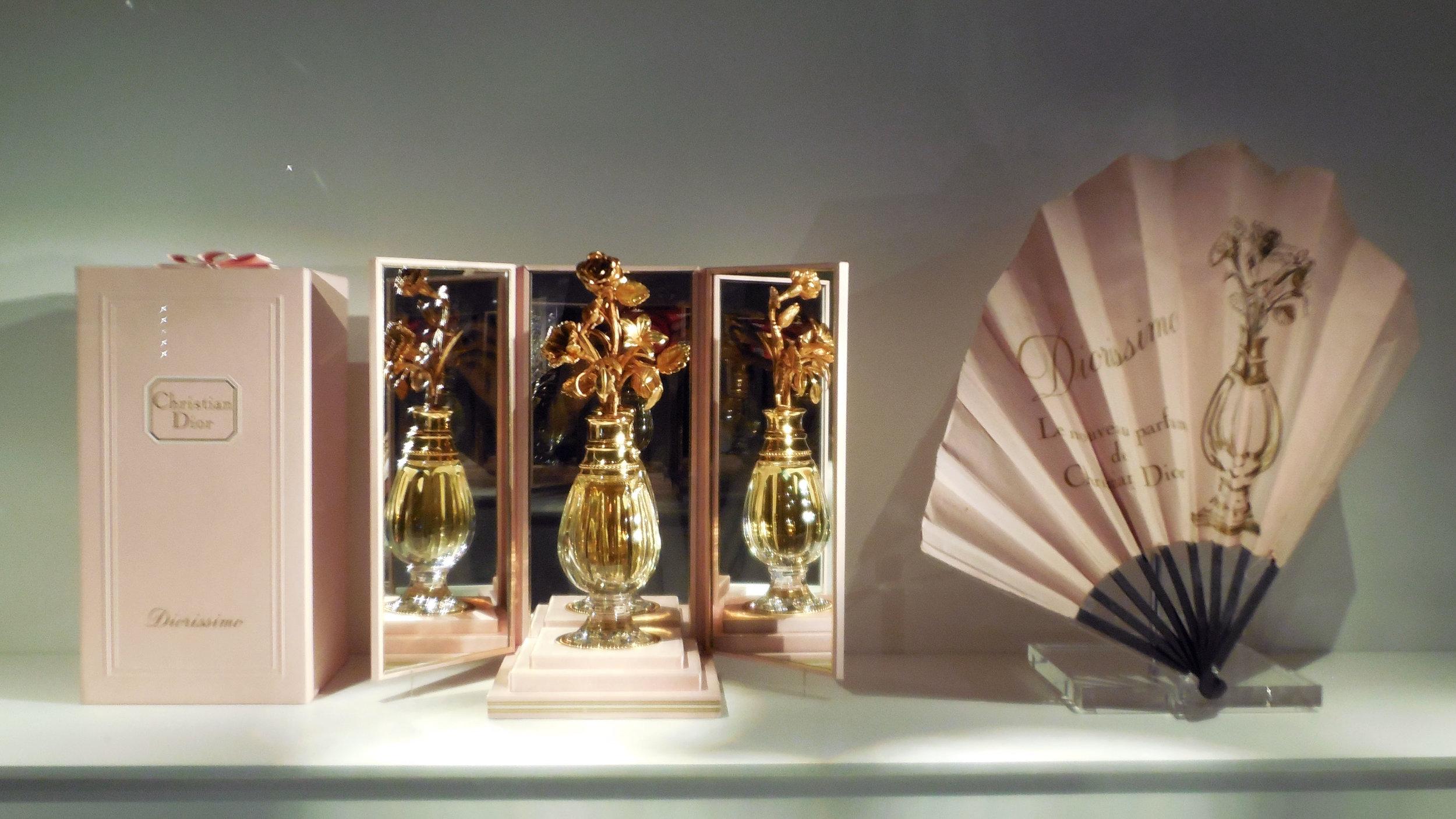 Dior Perfume Bottle and Fan.jpg