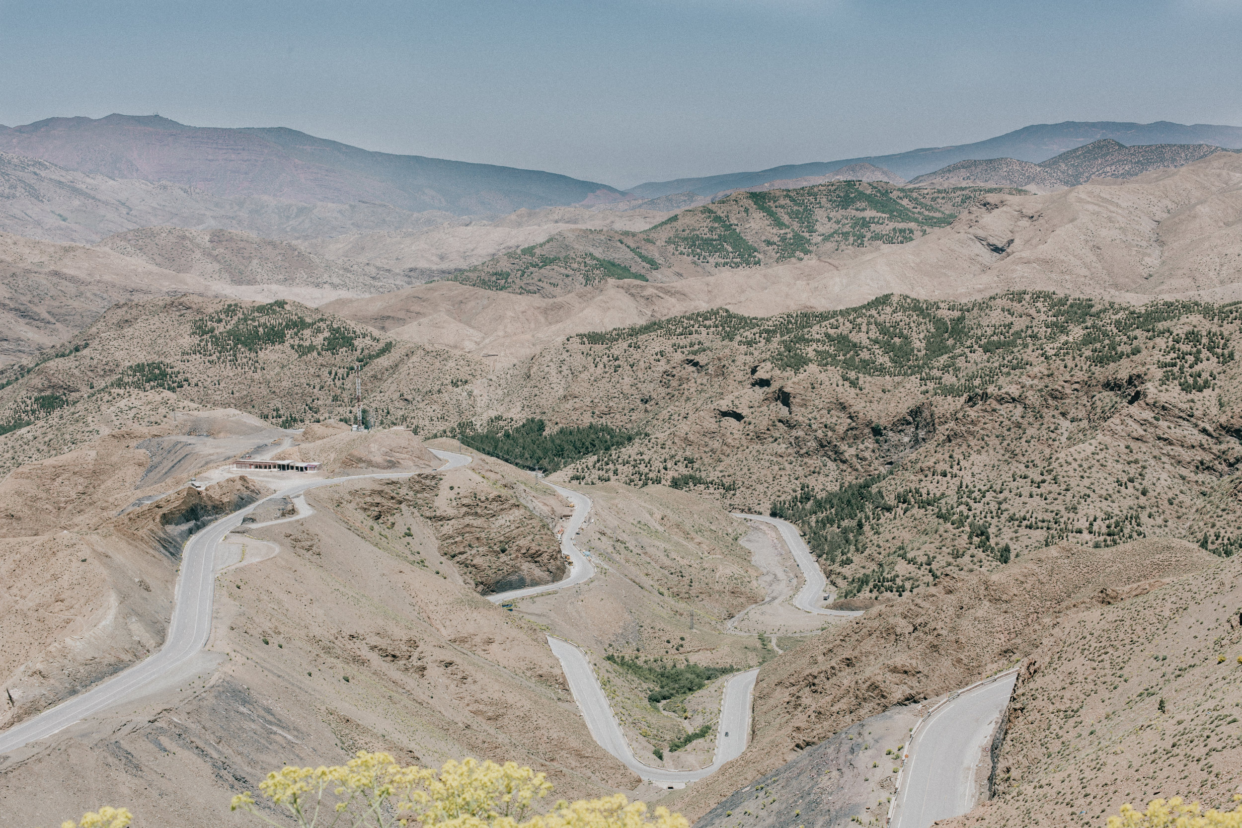Journeying through the Atlas Mountains and into the Desert via beautiful winding roads.