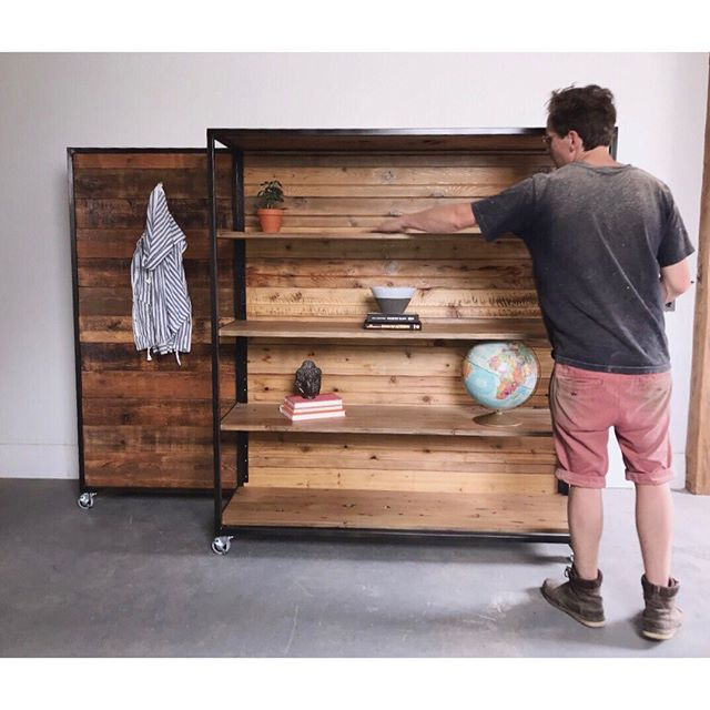 The Mod Shelving Unit  Utilize any space with this functional art piece, acting as a shelving unit, room divider, rolling pantry, simply put, versatile, beautiful and functional.  Shown in:  Plain + Simple [Rustic Pine + Blackened Patina Steel]  Also Available in:  Modern Mod [white oak / walnut / maple + white steel finish]  The Ath·e·nae·um [Black Walnut + Brass Finish]  Starting @$1650.