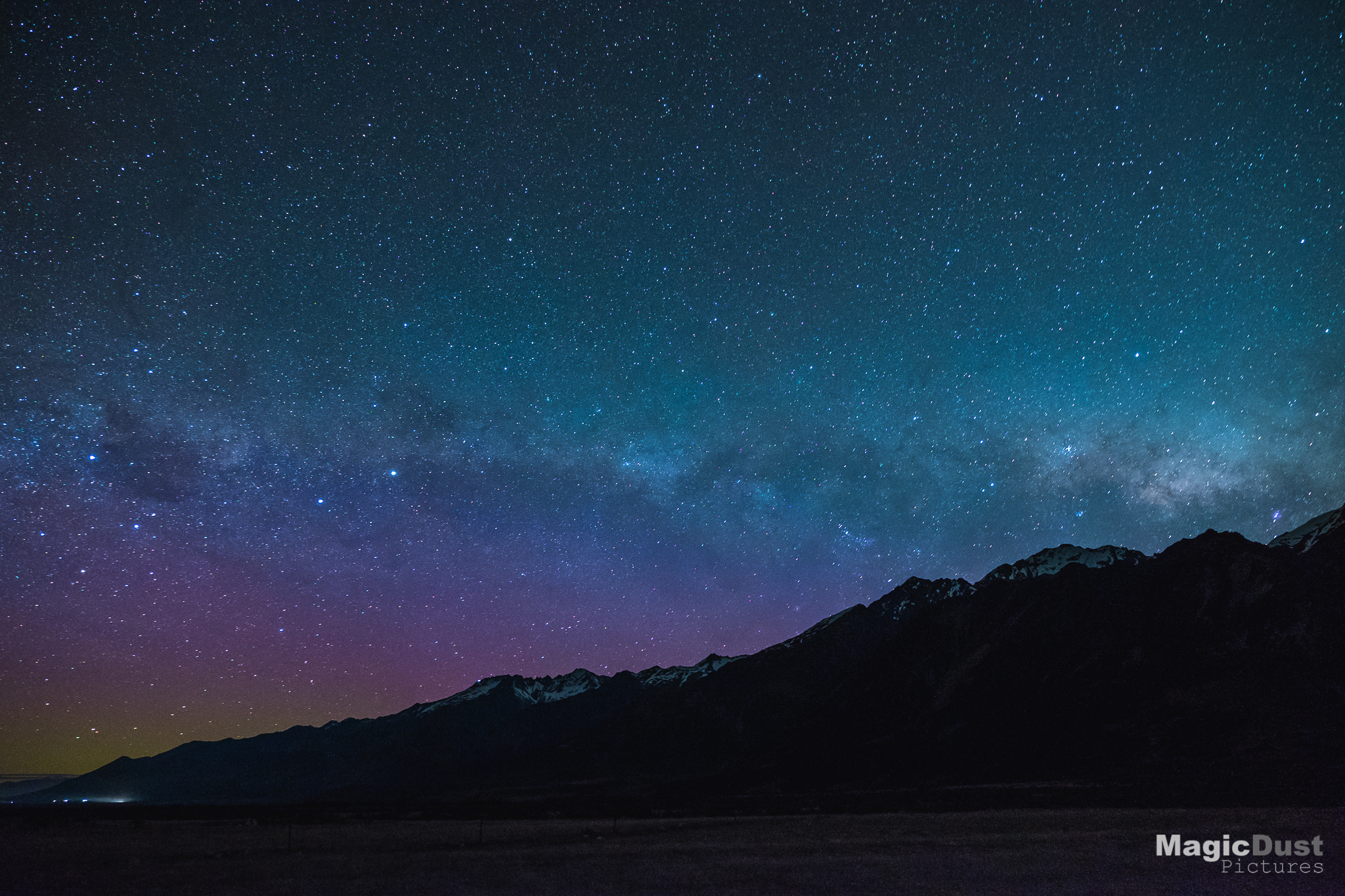 The galactic centre of the Milky Way setting behind the mountains at Mount Cook Village