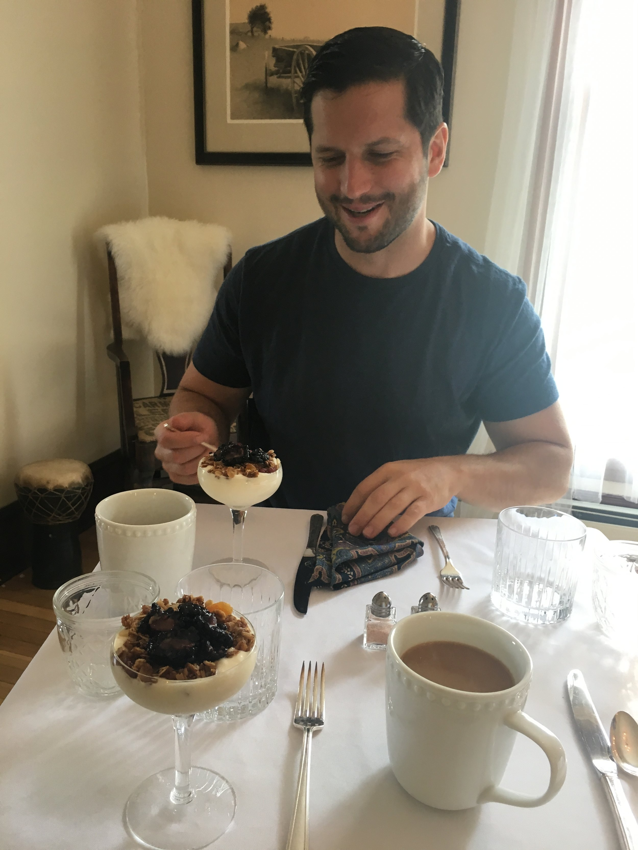 My husband, enjoying breakfast!
