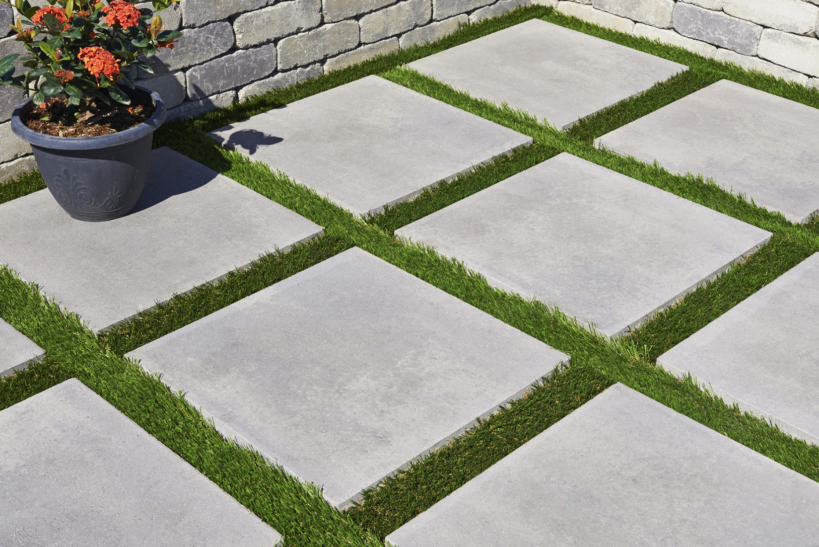 "alt=""Artifical Turf and Concrete"""