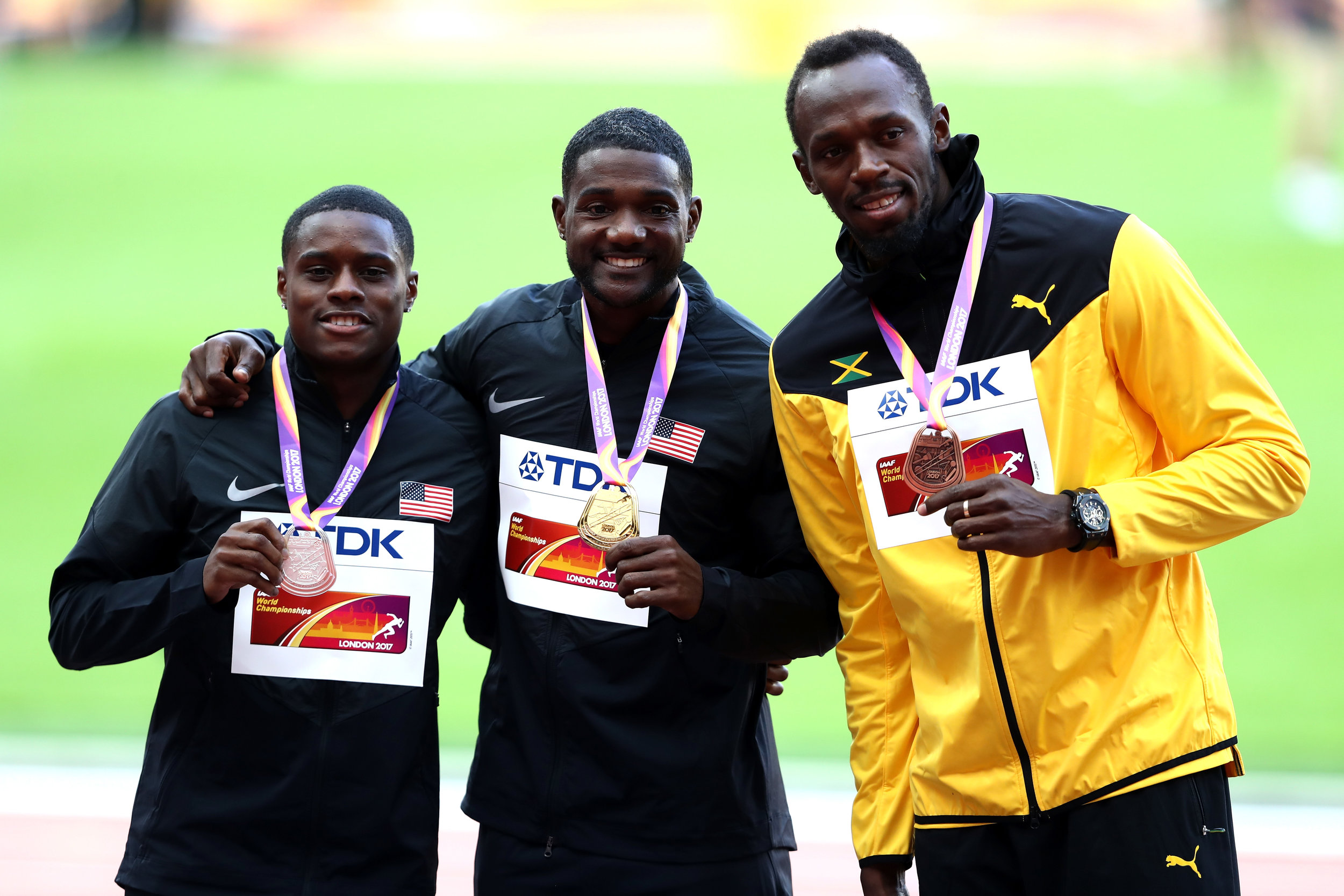Christian Coleman, Justin Gatlin and Usain Bolt on the medals stand // Getty Images for IAAF