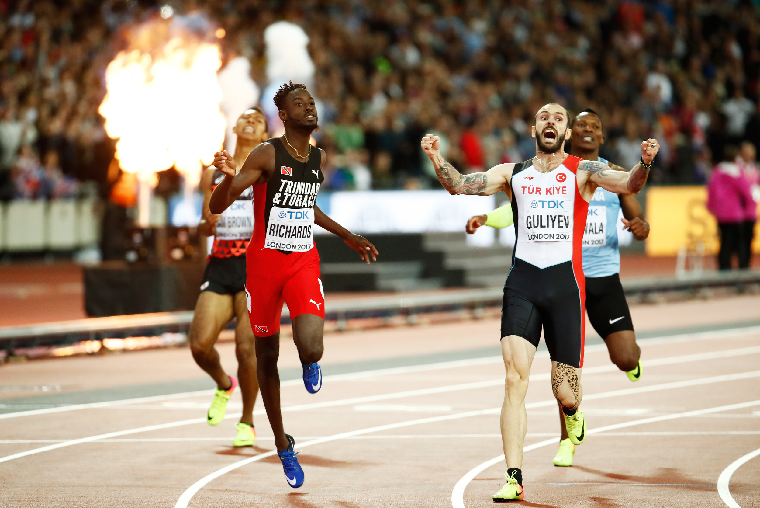 Ramil Guliyev of Turkey wins the 200, Jereem Richards two-hundredths behind in third, Isaac Makwala in sky-blue behind in sixth // Getty Images for IAAF