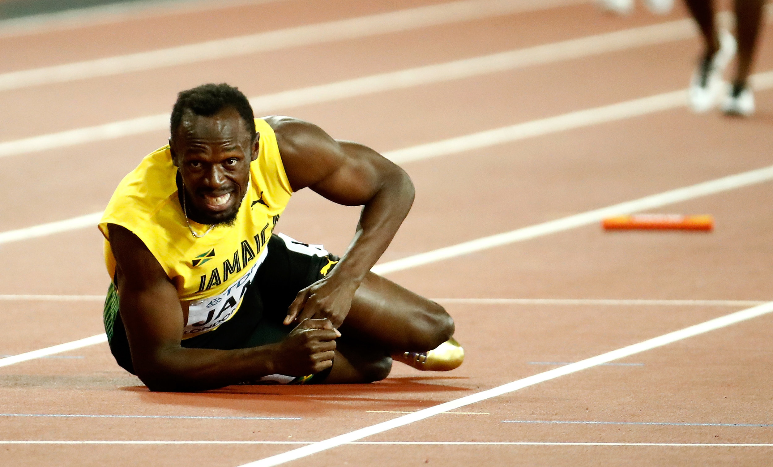 Usain Bolt on the track in the men's 4×1 relay // Getty Images for IAAF