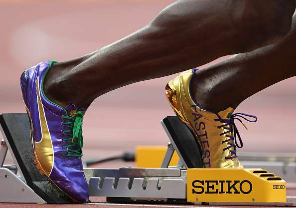 Bolt's shoes say 'Fastest' and 'Forever' but getting out of those blocks, always a challenge, proved problematic // Getty Images