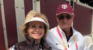Texas A&M coach Pat Henry, right, and his wife Gail at Olympic Stadium