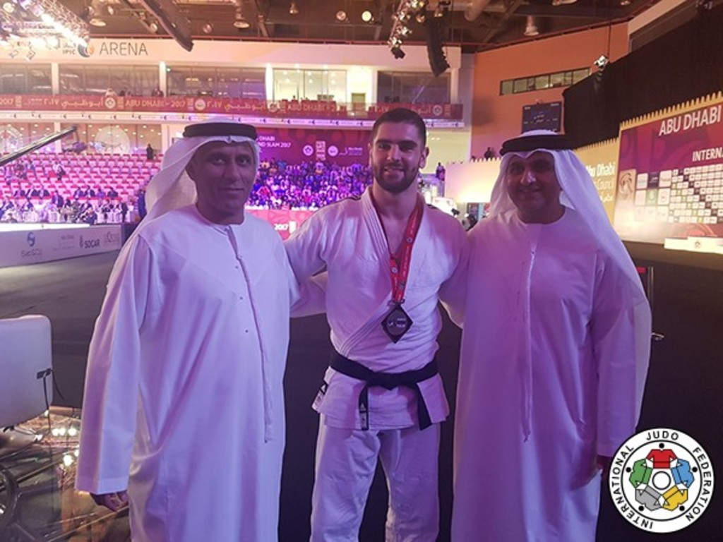 At the IPIC Arena: Israeli judoka Peter Paltchik with UAE judo federation president His Excellency Mohammad Bin Thaloub Al Darei and Aref Al-Awani// IJF