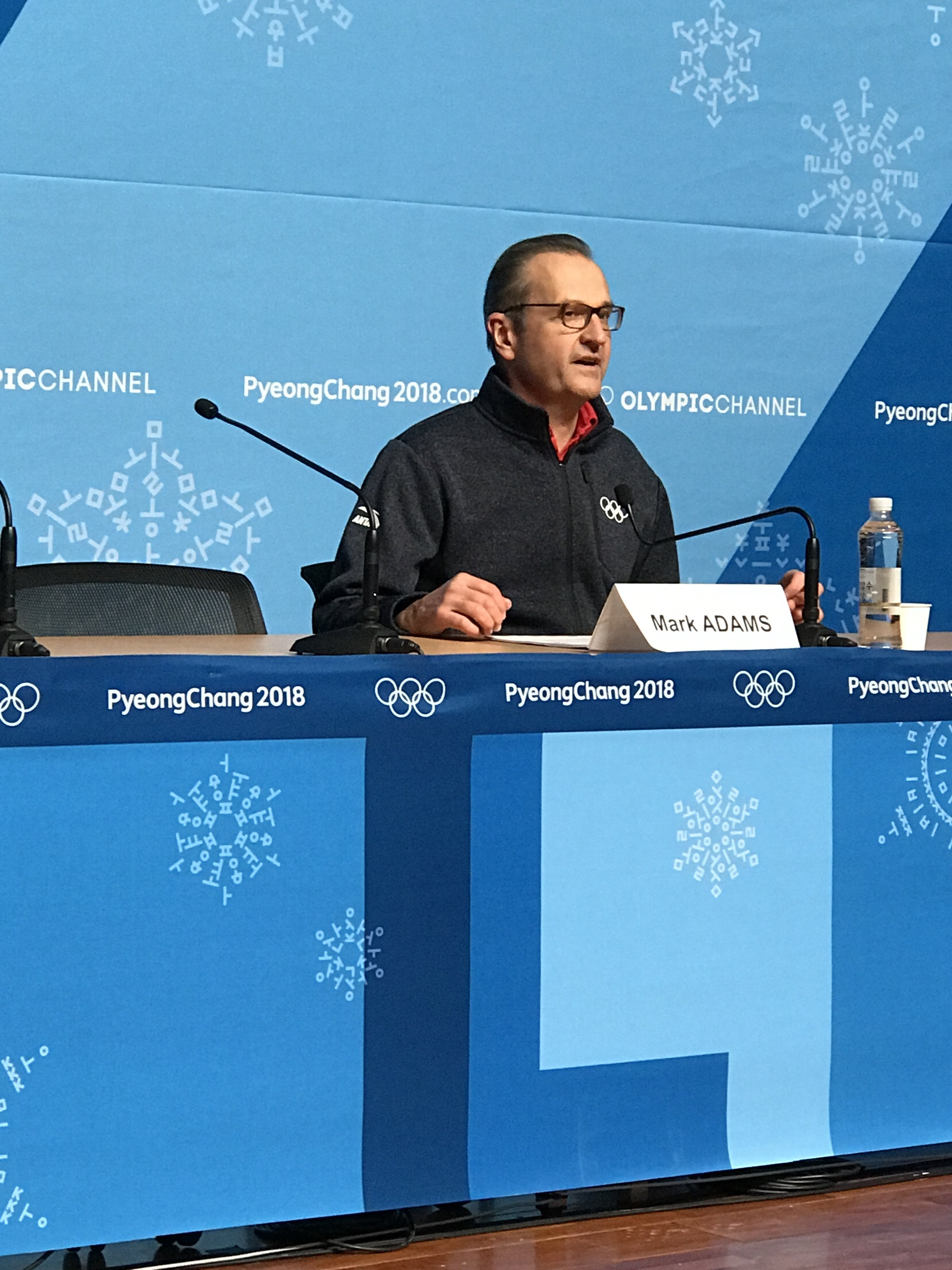 Spokesman Mark Adams reading the IOC statement Thursday evening at the PC 2018 Main Press Center after the Court for Arbitration for Sport announcement