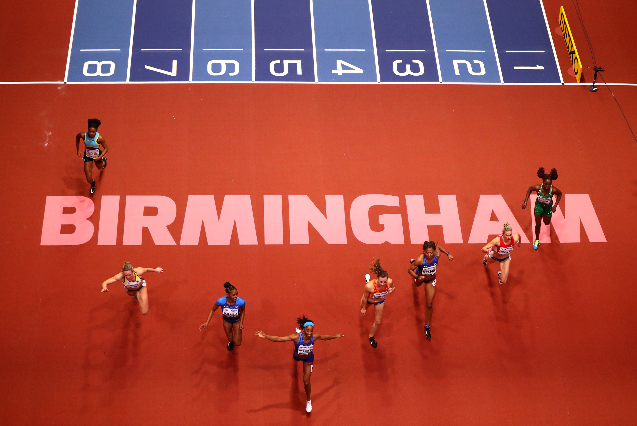 Keni Harrison leads the almost-perfect chevron in the 60-meter hurdles //Michael Steele/Getty Images for IAAF)