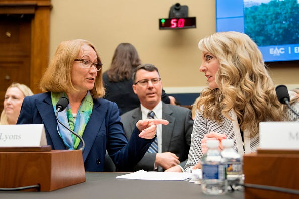 Susanne Lyons of the USOC and USA Gymnastics' Kerry Perry at Wednesday's congressional hearing // Jim Watson/AFP/Getty Images
