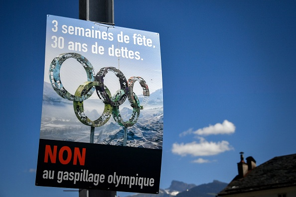 """A """"No on Sion 2026"""" campaign poster. It reads,""""Three weeks of partying, 30 years of debt - No to Olympic waste"""" // Getty Images"""