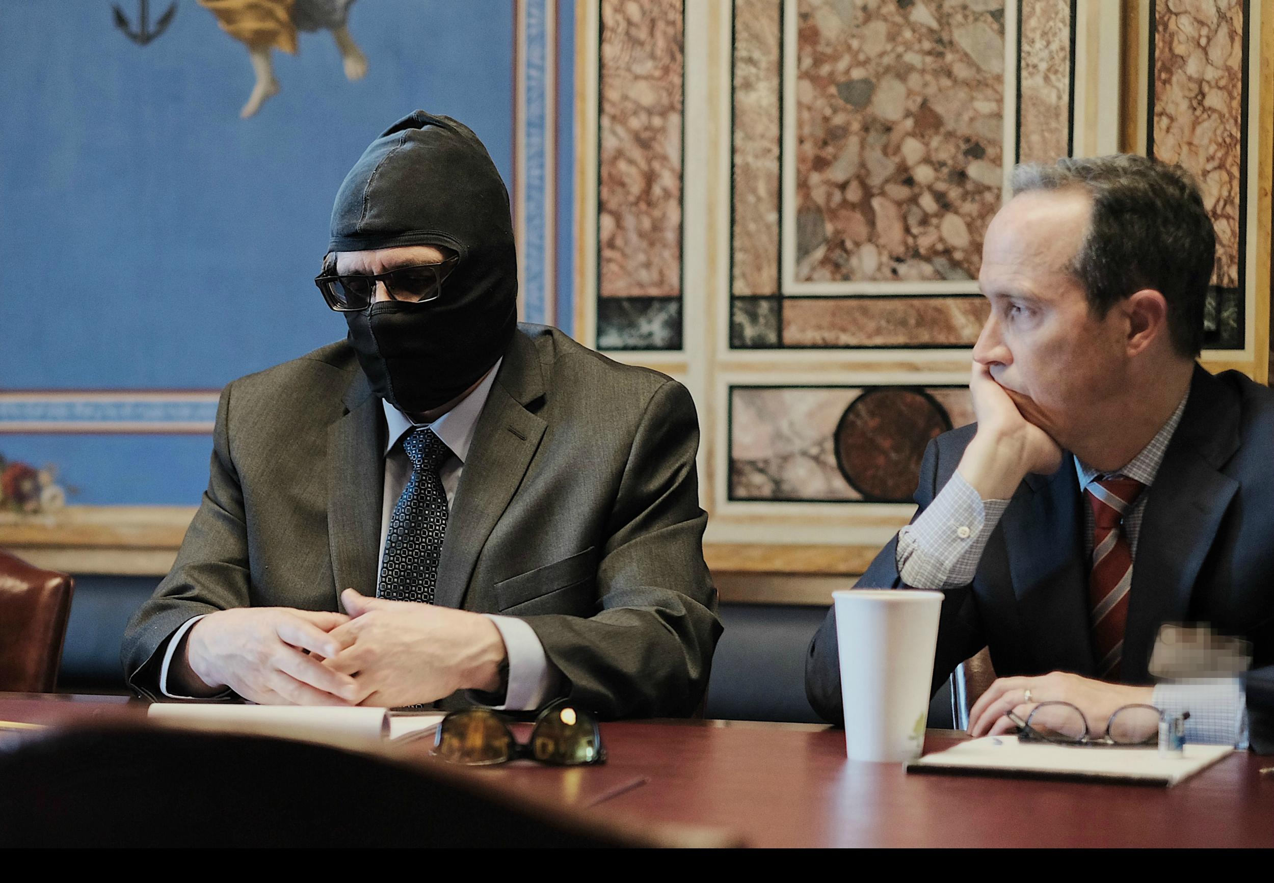 Grigory Rodchenkov, in ski mask, with lawyer Jim Walden // Helsinki Commission