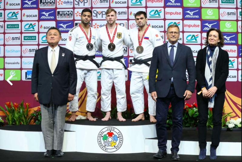 Paris 2019 Grand Slam men's 81-kilo podium photo, silver medalist Sagi Muki of Israel at left, flanking winner Dominic Ressel of Germany and Alan Khubetsov of Russia. Missing: the other bronze medalist, Mollaei of Iran // IJF