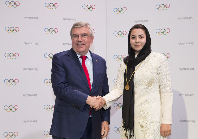 The IOC president, Thomas Bach, welcoming new member Samira Asghari at ceremonies last year in Buenos Aires // IOC / Flickr