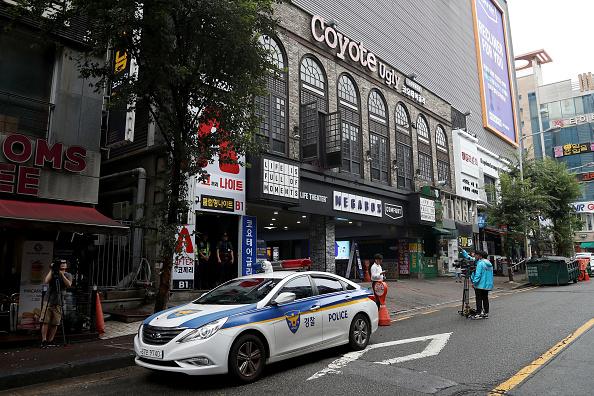 Police stand watch Saturday in front of the Coyote Ugly nightclub // Getty Images