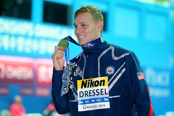 Caeleb Dressel on the medals stand with the bandana paying tribune to a cherished teacher // Getty Images