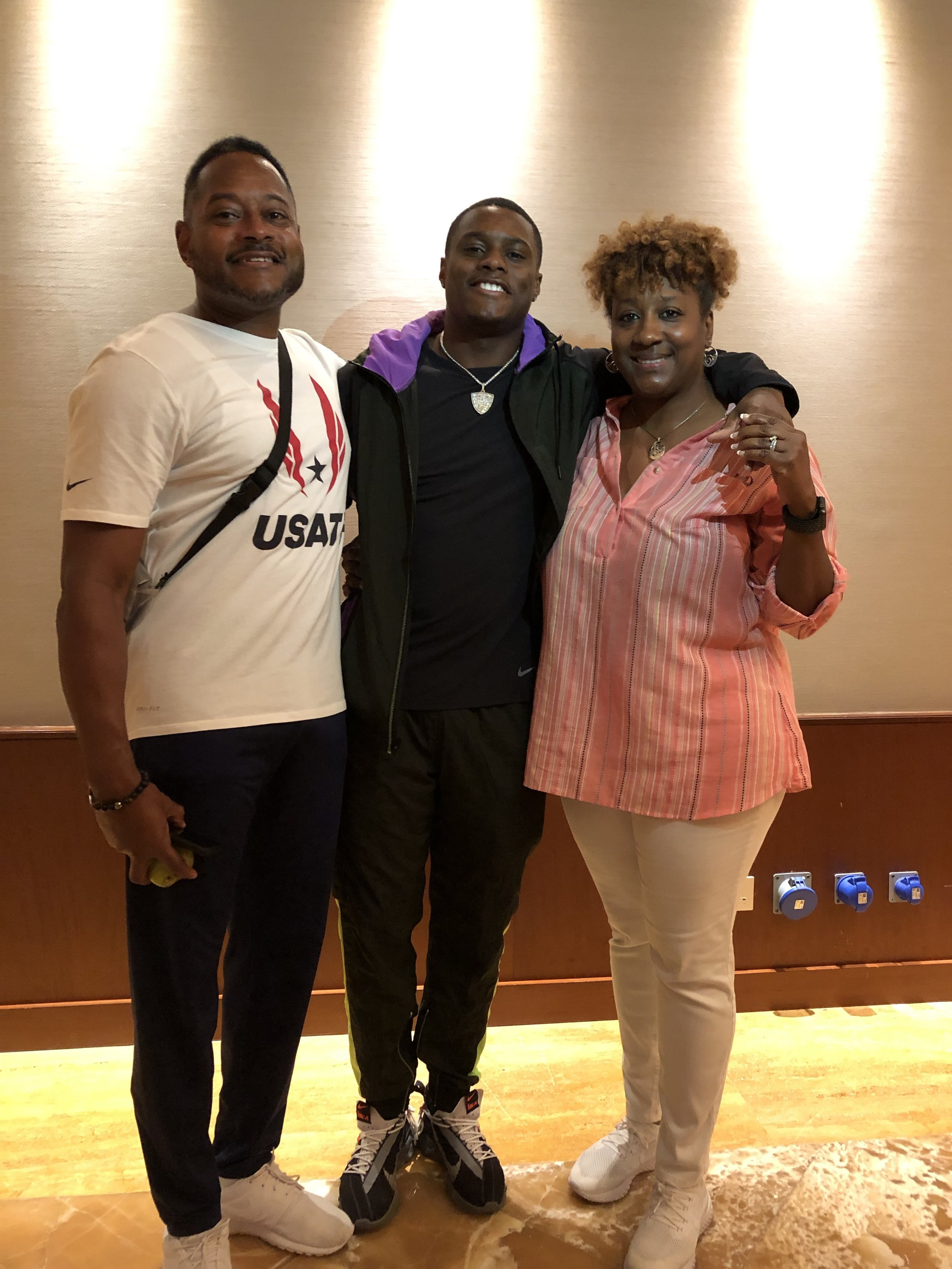Christian Coleman with his father, Seth, and mother, Daphne
