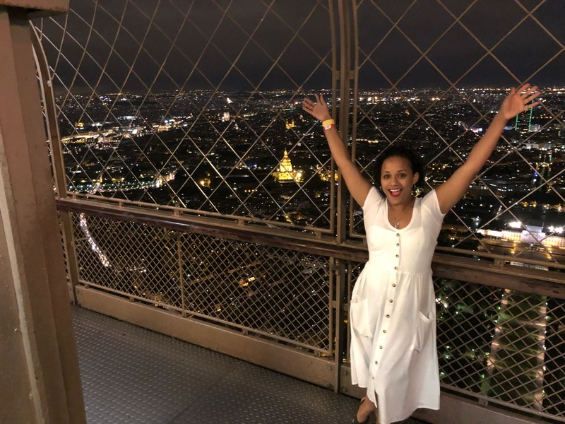 Me stopping just before the tippy-top of the Eiffel Tower