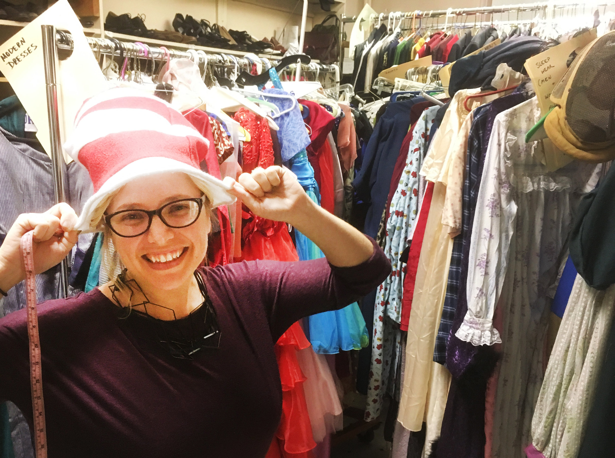 Jill Keys, costume designer for  This Is The Week That Is , making the rounds in 1812 Productions' costume storage.