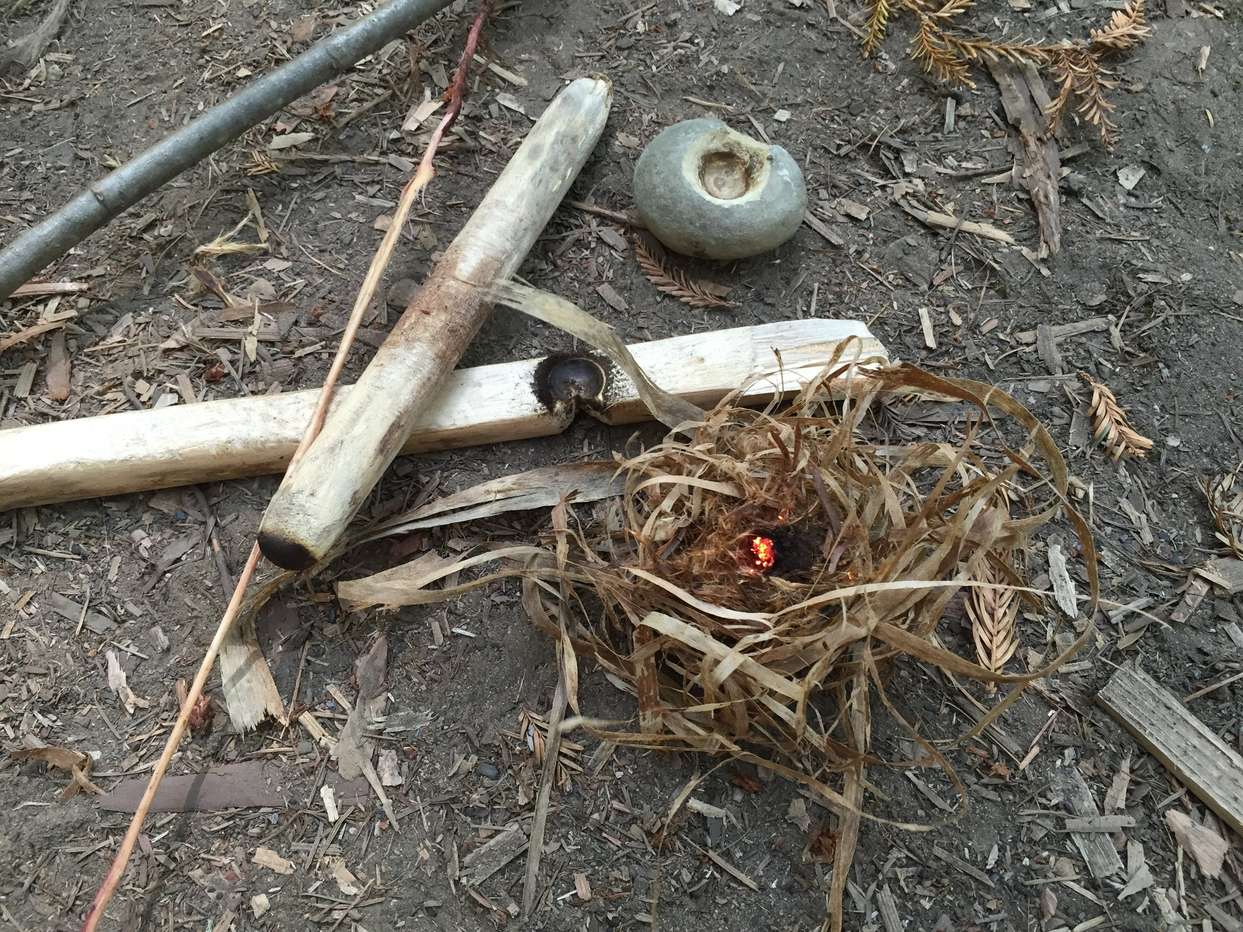 """""""Off The Land"""" Bowdrill Fire, Hand pecked stone handhold and rootlet cord."""