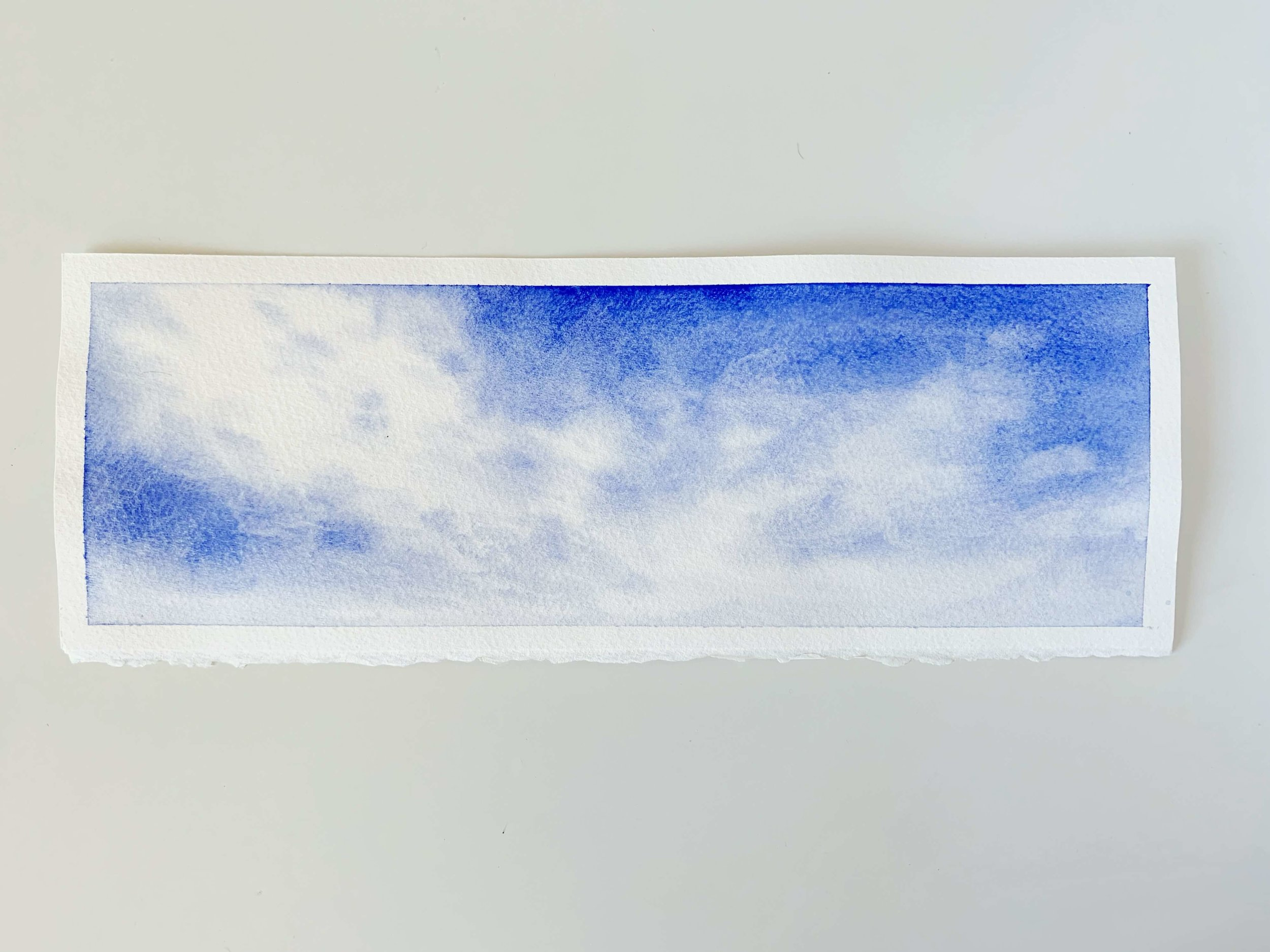 Watercolor Ultramarine Blue Sky and Clouds