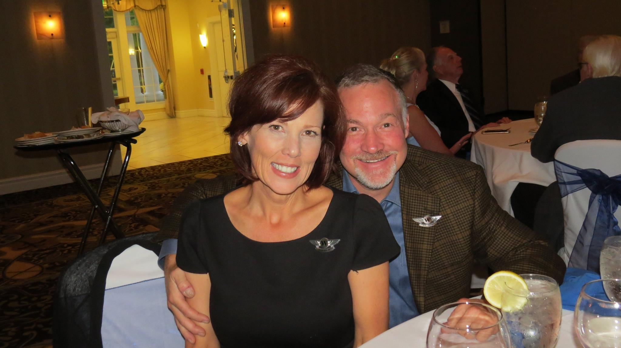 Dr. Criscione and his wife Linda smiling at a dinner conference