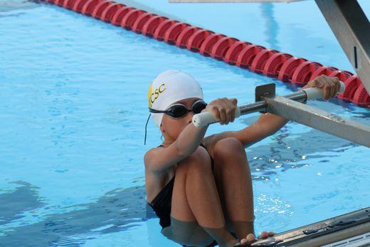 b90d4e76-614e-48a2-827c-fe393232758f-young_swimmer_first_meet_ready_to_swim_backstroke.jpg