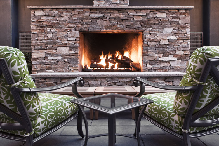 BEAUTIFUL, RELAXING ENVIRONS  Tastefully furnished, this covered courtyard with stone fireplace is the perfect in-city outdoor retreat. Enjoy a glass of wine with friends in this one-of-a-kind, perfectly tranquil patio.