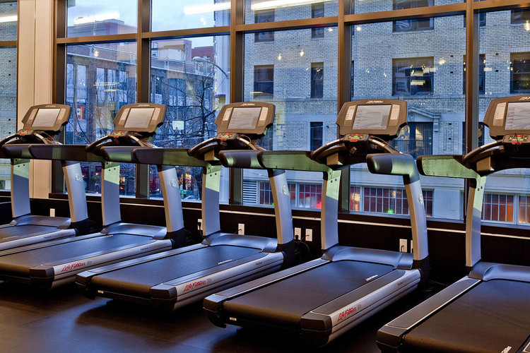 MODERN & CONVENIENT  ON-SITE GYM  Seattle's largest and most complete condominium fitness center. Enjoy two stationary lap pools, extensive free weight section, state-of-the-art cardio machines, yoga studio, hot tub, steam rooms, and changing facility.