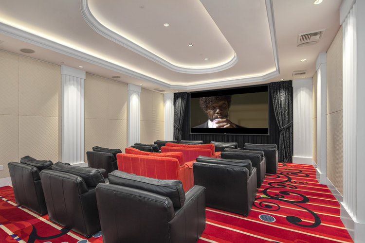 HIGH-END HOME MOVIE EXPERIENCE  A private state of the art theater with ample luxurious seating. This space can also be easily transformed into a fully functional boardroom for twenty people.
