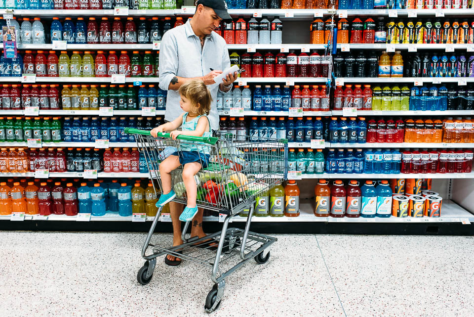 father grocery shopping with children
