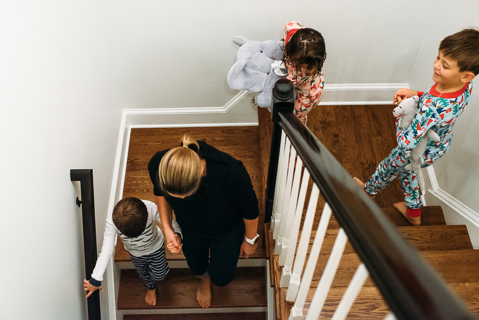 Mother and three children walking downstairs.