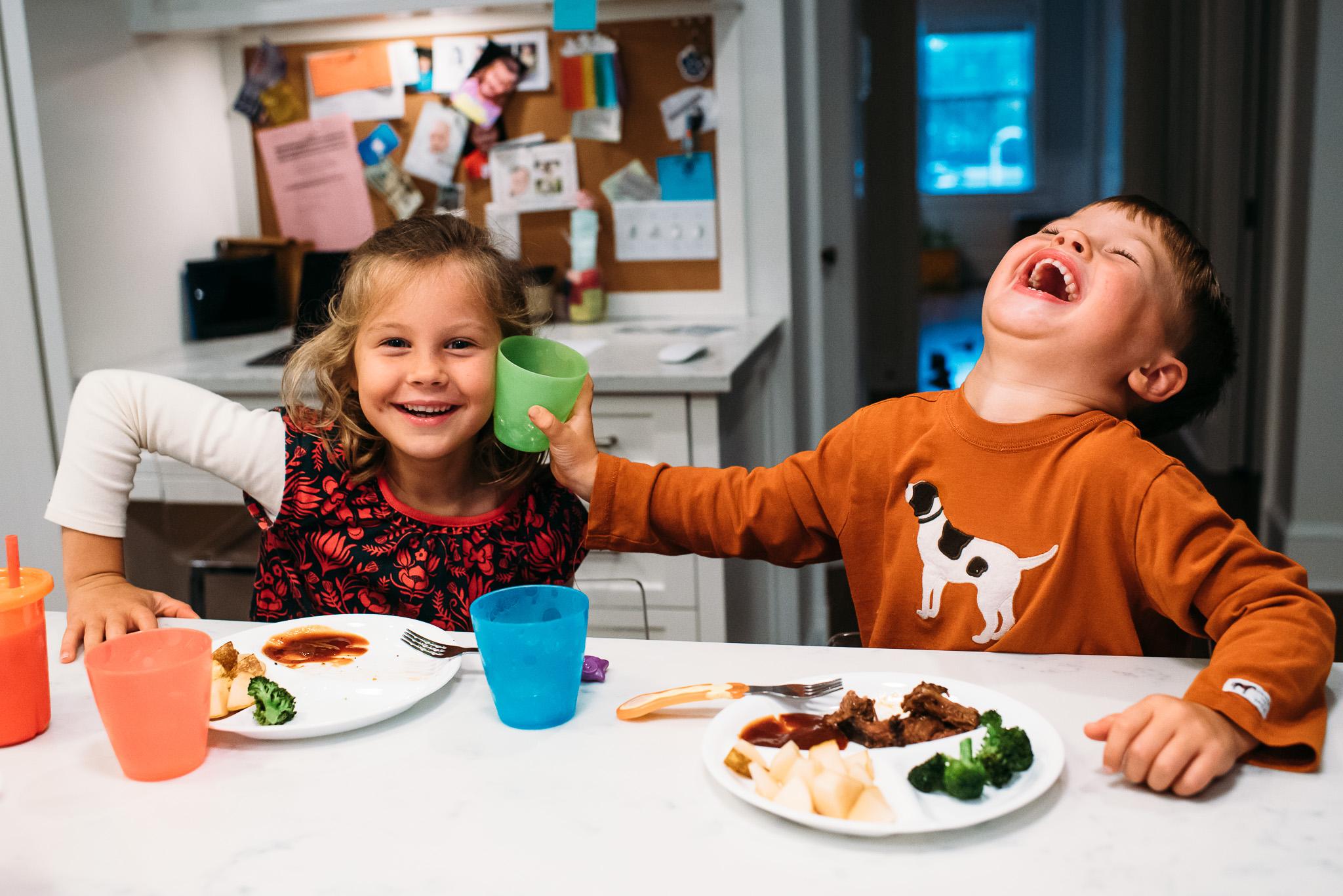 Children having fun while eating dinner.