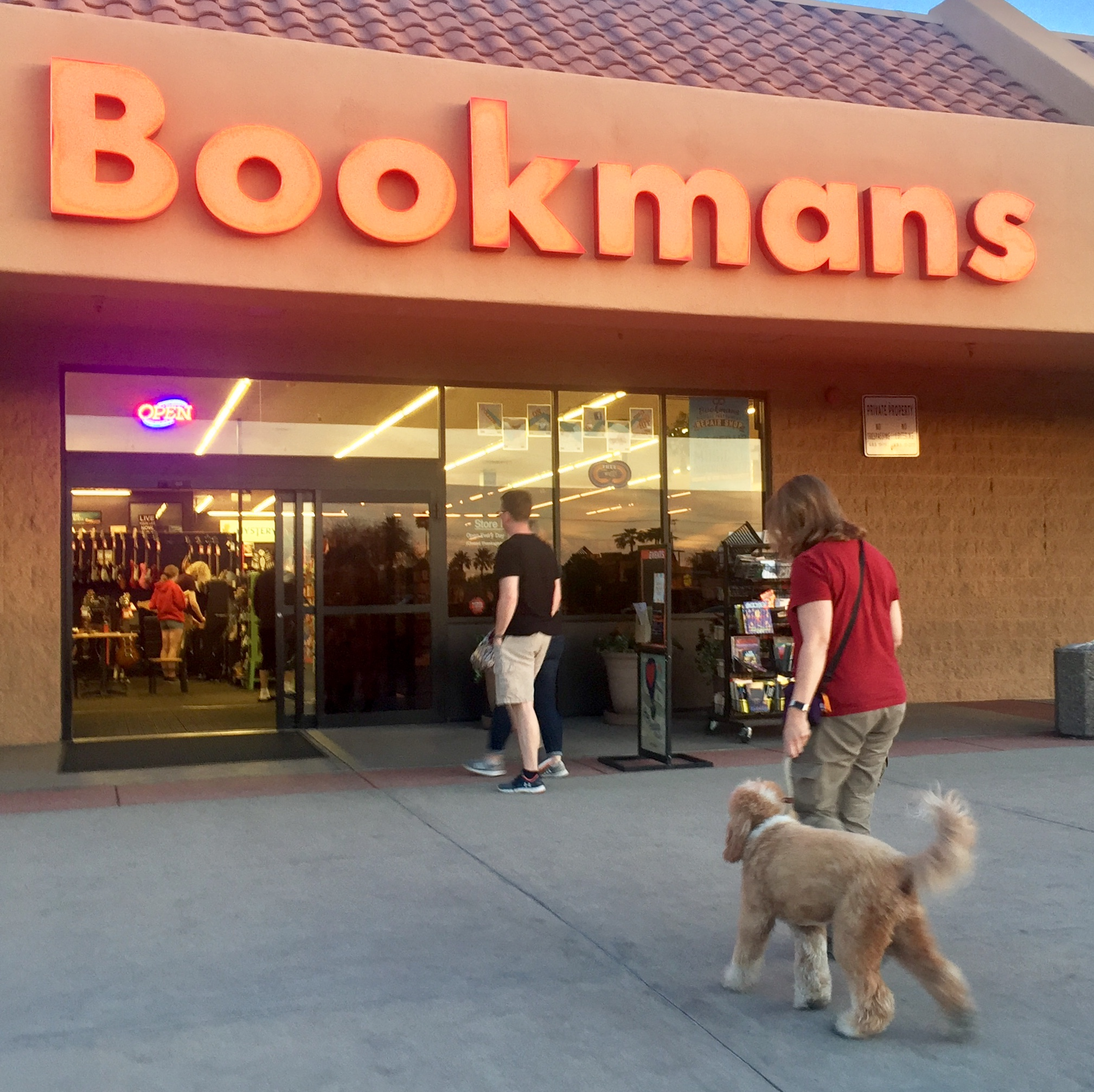Bernie McSquare and I enter Bookmans Used Bookstore on a Tuesday evening to practice walking through a crowd in preparation for our CGC test.